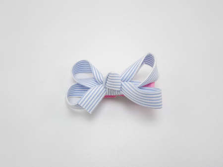 Baby girl ribbon hair pin use to tie the hair of a person
