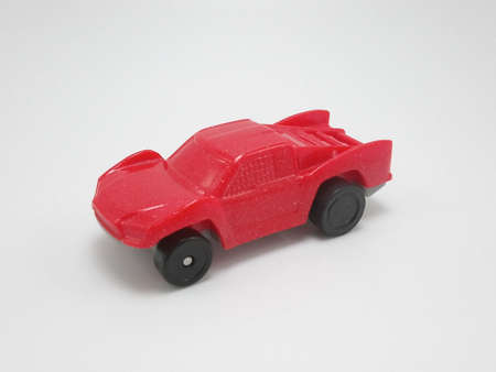 Small red plastic toy car