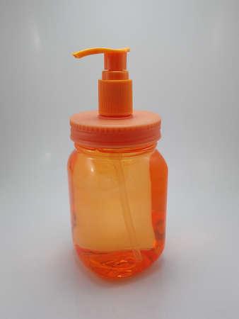 Orange color hand wash soap press down button plastic bottle