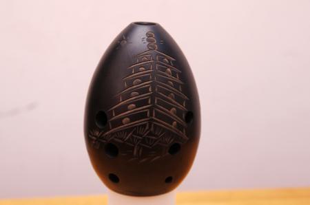 blaasinstrument: Xun, een oude eivormige, gaten blaasinstrument