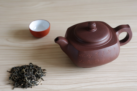 Teapot made of Yixing red stoneware photo