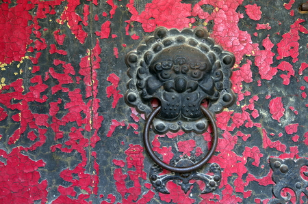 holder for door knocker  on a red mottled door photo