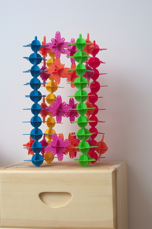 colourful plastic toy and artificial flowers on the garderobe