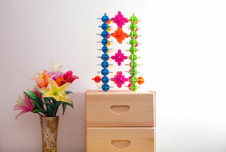 garderobe: colourful plastic toy and artificial flowers on the garderobe