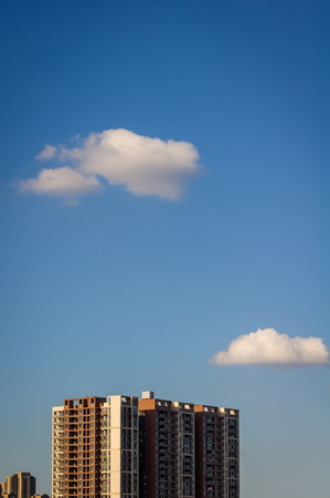 Clouds above the city building Stock Photo