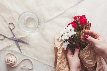 Woman is making lovely bouquet for special occasion