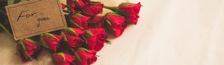 happy valentines day: Bunch of red roses with romantic card, panorama