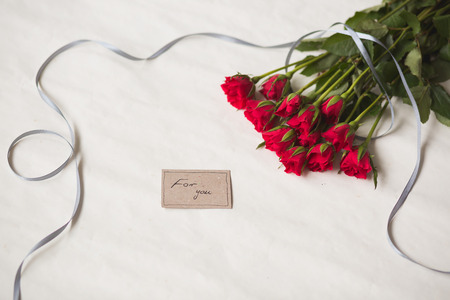 text message: Red roses are romantic surprise for loved one
