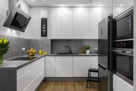 Beautifully designed kitchen in white and grey with steel elements Imagens