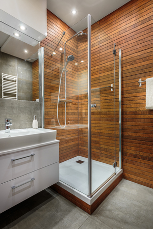 Stylish and modern designed wooden wall in shower cabin Banco de Imagens