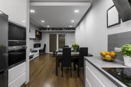 apartment living: Modern design apartment with kitchen connected to living room