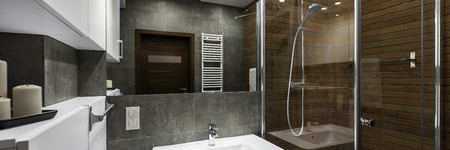 Modern bathroom interior designed in white, gray and brown, panorama
