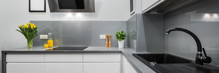 kitchen countertops: Panorama of kitchen countertops in modern and simple interior Stock Photo