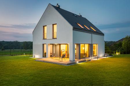 Beautiful villa with wide backyard and decorative outdoor lighting, external view Standard-Bild