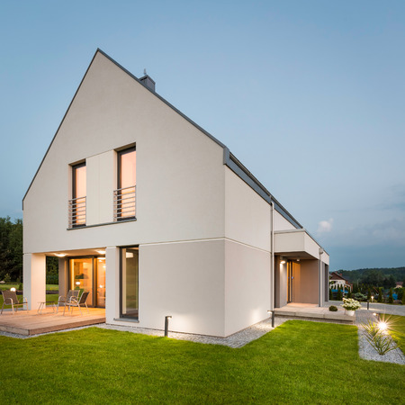 New style villa with simple garden, night view Imagens