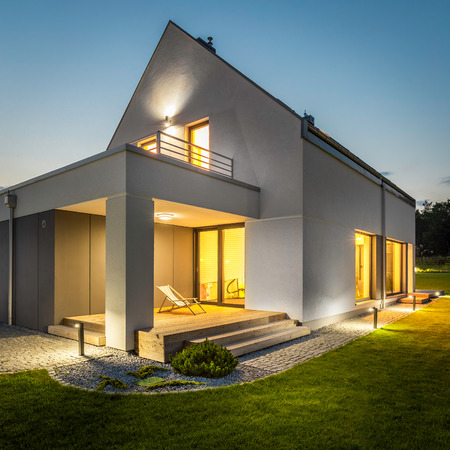 Night external view of a contemporary house with outdoor lighting
