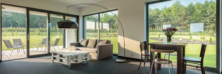 living room wall: Simple living and dining room combination, spacious interior with window wall system, panorama