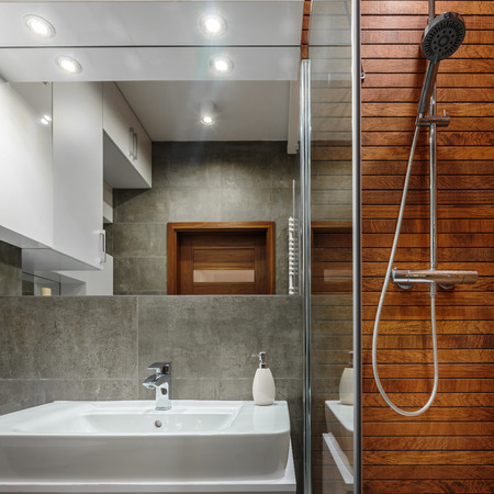 Shower with wooden wall as modern design in bathroom Stok Fotoğraf