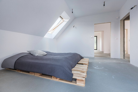 attic window: White attic flat with hipster DIY bed and window