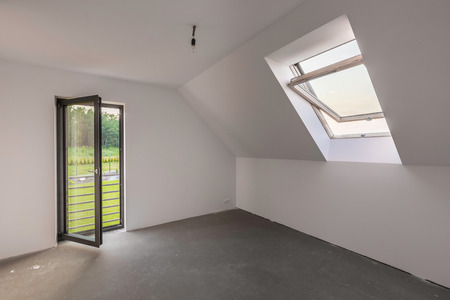 attic window: White and spacious attic room with window and open glass balcony doors