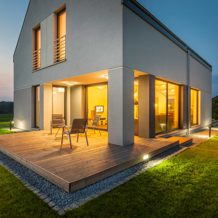 lighting: External view of modern house at night with all lights on Stock Photo