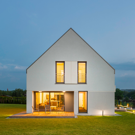 Simple form white house with beauty landscape, at night Standard-Bild