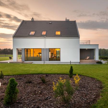 Photo of elegant and modern house with stylish backyard