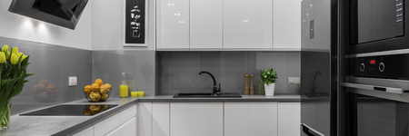 Modern and comfortable white and grey kitchen, panorama