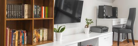 modern living: Big bookshelf in modern living room, panorama Stock Photo