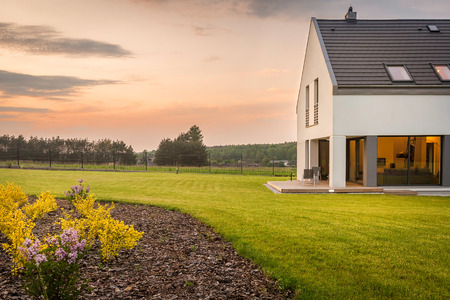 New design white villa with a wide lawn,external view