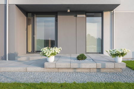 Grey villa with new design entrance, lawn, glass doors and decorative plants