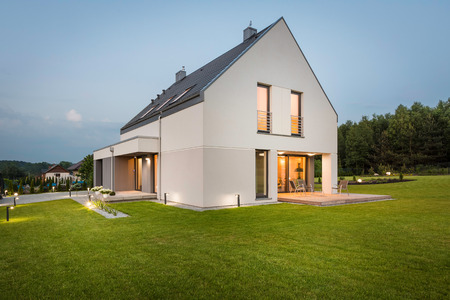 Photo of modern house with outdoor lighting at night external new design light house with wide lawn and decorative outdoor lighting external view photo mozeypictures Choice Image