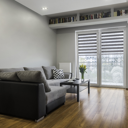 Grey sofa and coffee table in a bright apartment relaxing space