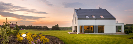 External view of modern and beautiful home with large backyard, panorama