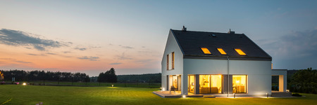 outdoor lighting: Panoramic photo of modern house with outdoor and indoor lighting, at night