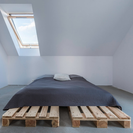 attic window: One big bed in eco style in bright attic with window