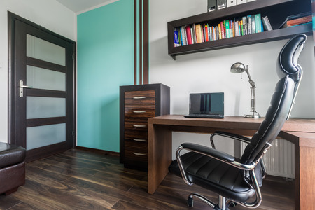 comfortable home office. Spaciosu Home Office With Dark Brown Furniture, Comfortable Chair And  Decorative Turquoise Wall Detail Stock T