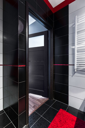 bathroom tiles: Image of a bathroom interior with black high gloss tiles Stock Photo