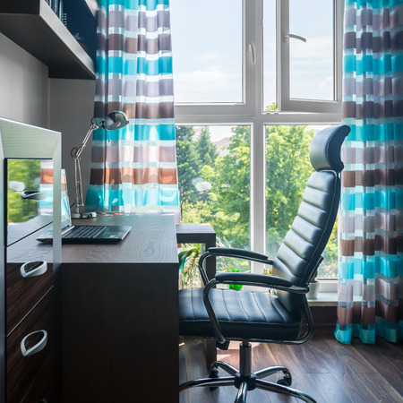 comfortable home office. Simple And Comfortable Home Office With Desk, Armchair, Big Window Decorative Curtains Photo