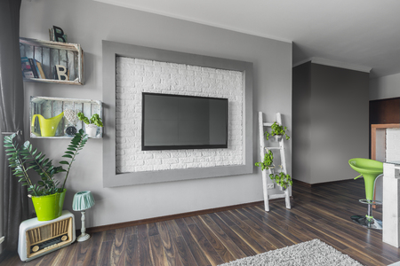 decorative wall: Living room with big tv hanging on a decorative wall with white brick effect