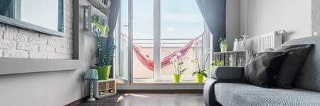 balcony door: Open balcony door to bright and modern living room, panorama