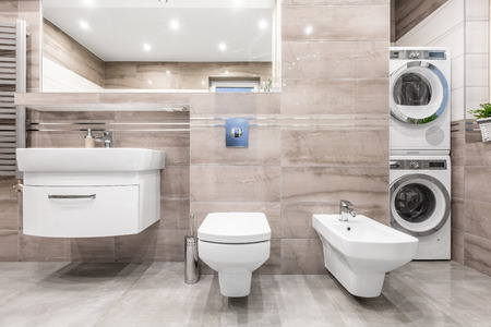 bidet: High gloss bathroom with basin cabinet, mirror, toilet, bidet, washer and clothes dryer