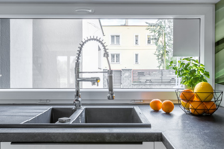 double sink: Double basin kitchen sink, solid worktop and window
