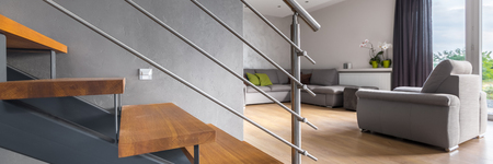 balcony door: Panorama of new design bright living room with balcony door and wooden staircase Stock Photo