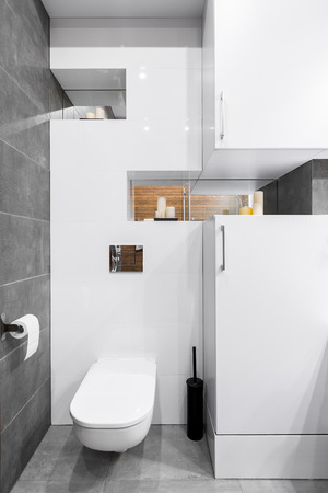 tiling: New style bathroom with white furniture and grey tiling