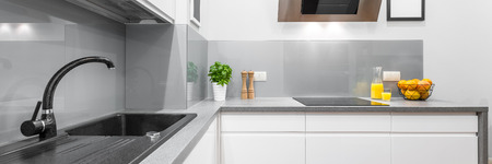 granite: Panorama of stylish kitchen interior in white with granite and solid countertop