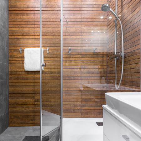 bathroom tiles: Modern bathroom with walk in shower and wooden effect tiles