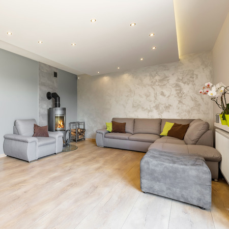 extra large: Spacious living room with extra large sofa, fireplace and decorative wall finish