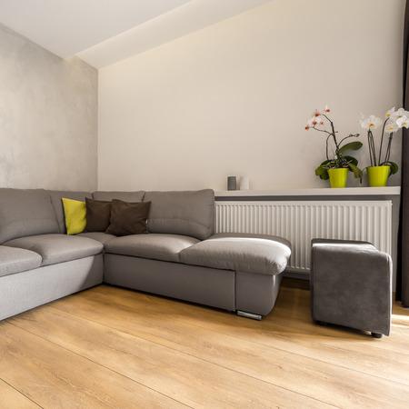 extra large: Villa interior with extra large sofa and decorative wall finish