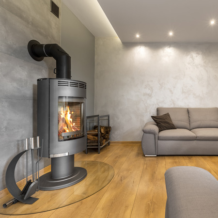 extra large: Grey living room with a fireplace, extra large sofa and decorative wall plaster